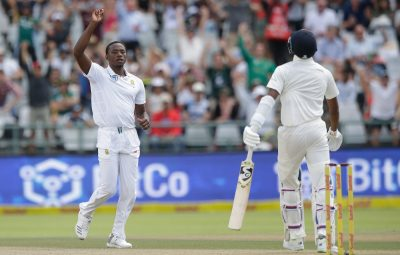 South African bowler Kagiso Rabada (L) celebrates the dismissal of Indian batsman Virat Kohli (R) during the fourth day of the first Test cricket match between South Africa and India at Newlands cricket ground on January 8, 2018 in Cape Town. / AFP PHOTO / GIANLUIGI GUERCIA