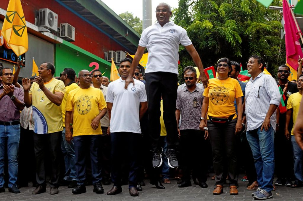 Ibrahim Mohamed Solih, Maldivian presidential candidate backed by the opposition coalition, jumps next to his supporters during the final campaign rally ahead of the presidential election in Male, Maldives September 22, 2018. REUTERS/Ashwa Faheem
