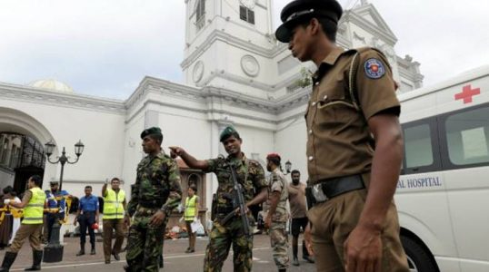 Sri-Lankan-military-officials-stand-guard-in-front-of-the-St.-Anthonys-Shrine-Kochchikade-church-after-an-explosion-in-Colombo-Sri-Lanka-April-21-2019.-REUTERSDinuka-Liyanawatte-2-770x435