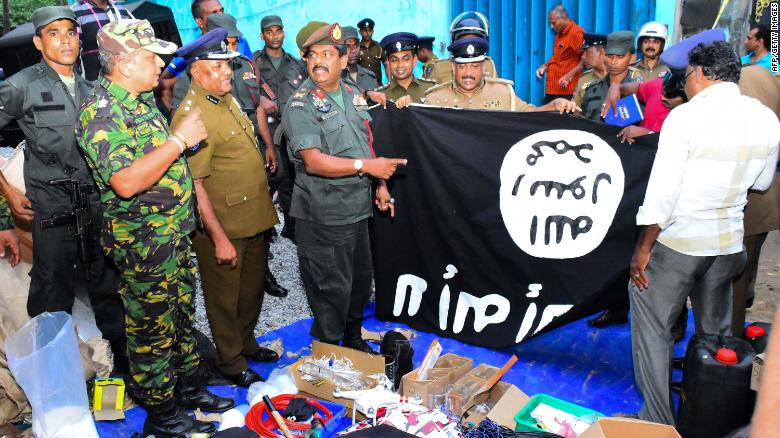 TOPSHOT - In this picture taken on April 26, 2019, security personnel inspects seized items after they raid what believed to be an Islamist safe house in the eastern town of Kalmunai. - Fifteen people, including six children, died during a raid by Sri Lankan security forces as three cornered suicide bombers blew themselves up and others were shot dead, police said on April 27. (Photo by STRINGER / AFP)        (Photo credit should read STRINGER/AFP/Getty Images)