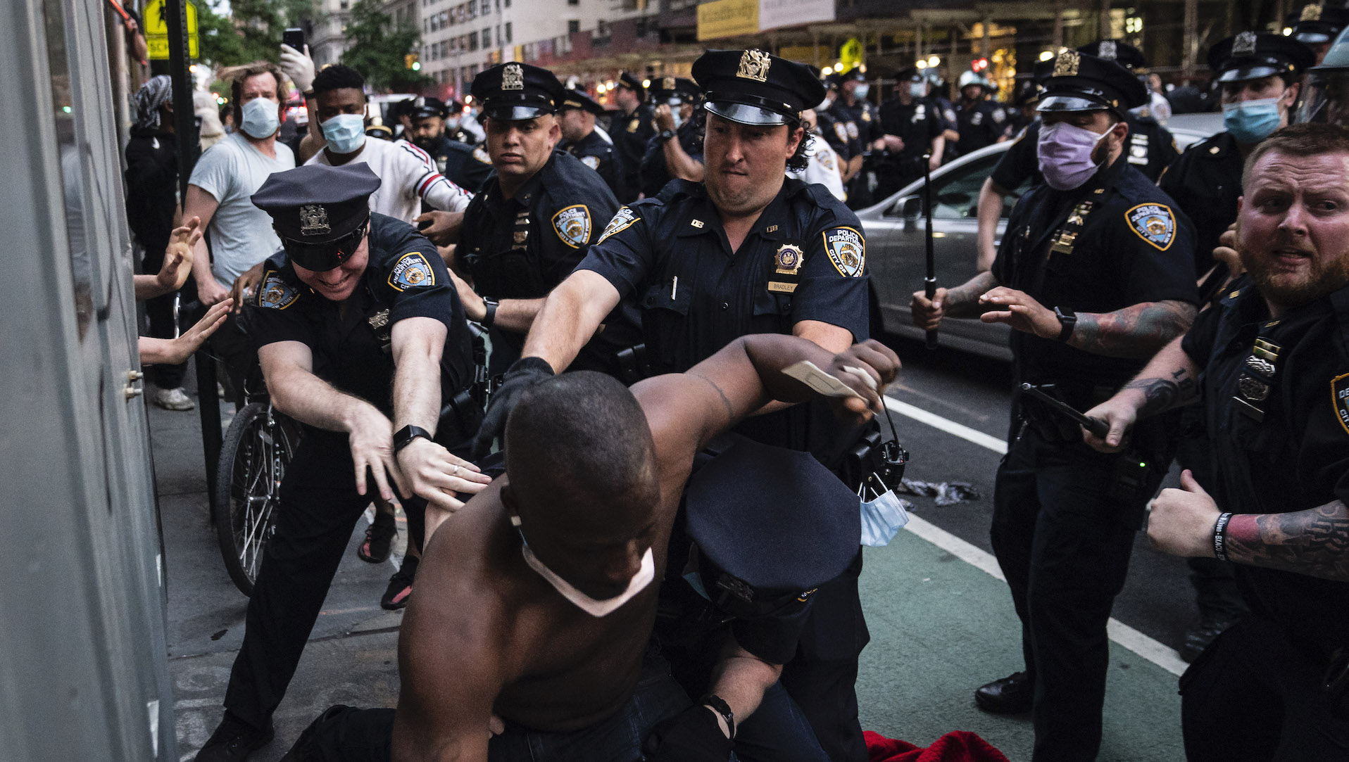 NEW YORK, NY - MAY 30: Officers pursue protesters as they march around downtown because of death of George Floyd while in police custody, on Saturday  May 30, 2020 in New York City, NY. (Photo by Jabin Botsford/The Washington Post)
